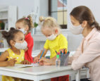 Young kids wearing masks while in a COVID-19 learning pod