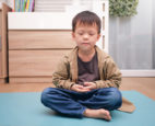 Young Asian boy meditating