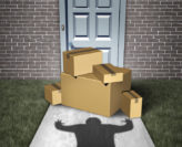 Image of porch pirate about to steal boxes in front of a house