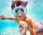 boy swimming at summer camp