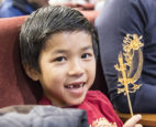A young participant in a previous Lunar New Year celebration