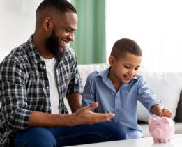 Father teaching son financial skills