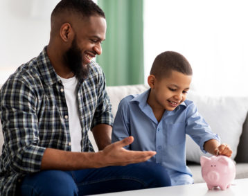Father teaching son financial skills